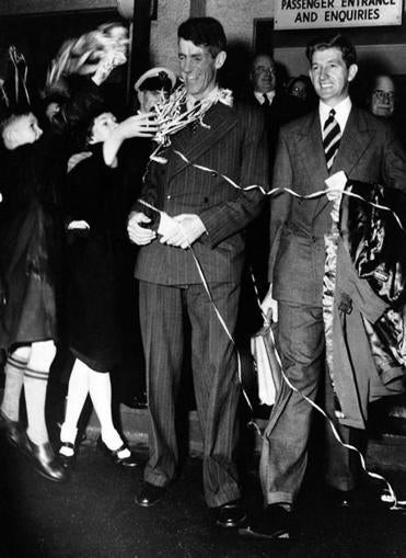 Sir Edmund Hillary (left) and George Lowe received a warm welcome in New Zealand after their climb in 1953.