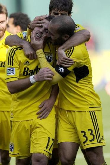 Columbus Crew forward Ben Speas celebrated his goal with teammate Federico Higuain against D.C. United on Saturday.