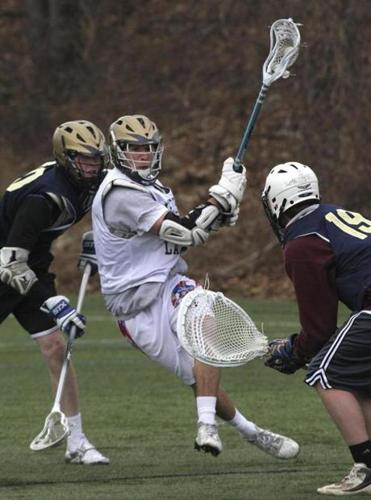 Nico Panepinto slices past Needham High School teammates trying to contain him during practice Monday.
