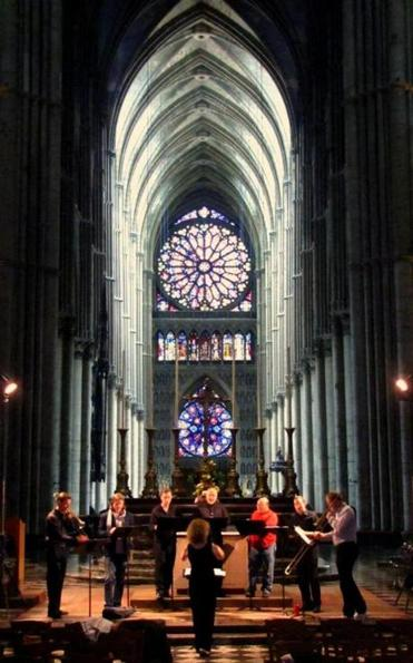 "Boston Camerata, led by artistic director Anne Azema, in the Cathedral of Reims in France in 2011, preparing to perform Guillaume de Machaut's ""Messe de Notre Dame."""