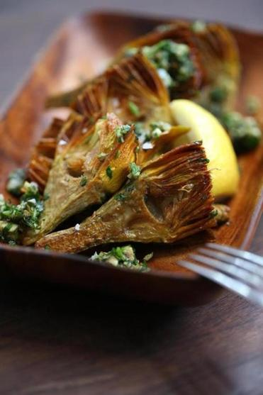 The braised artichokes starter is mixed includes anchovies and capers.