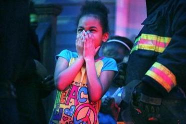 One little girl reacted to the fire that consumed her home at 10 Fox St. More than 30 people were left homeless.