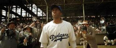 "Chadwick Boseman as Jackie Robinson, as he breaks into Major League Baseball with the Dodgers, in ""42."""