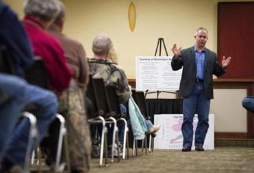 "Tim Huelskamp, shown meeting constituents in Salina, Kan., was elected to Congress in 2010. He is part of group known as the ""Hell No Caucus."""