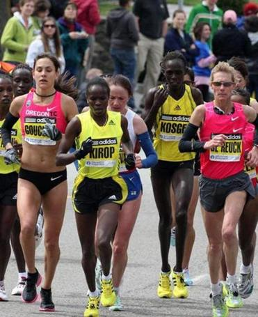 Kara Goucher (far left) is part of the lead pack of female Boston marathoners powering up Heartbreak Hill in 2009.