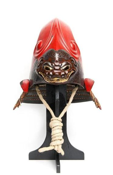 Red fantastic helmet with demonic shishi from the 1600s in the Currier show.