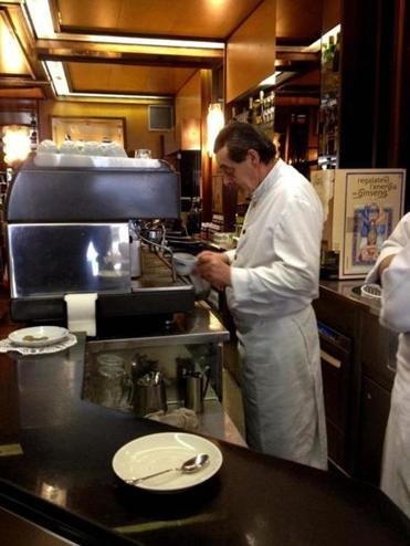 The baristas are dressed for the occasion in Rome, often in crisp white shirts, vests, or bowties.