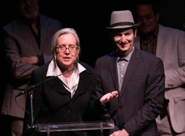 "Director Lisa Peterson and actor Denis O'Hare accepting a 2012 Lucille Lortel Award for outstanding solo show for their off-Broadway production of ""An Iliad,"" a piece they also wrote."