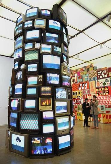 Barry McGee's untitled installation of a television tower .