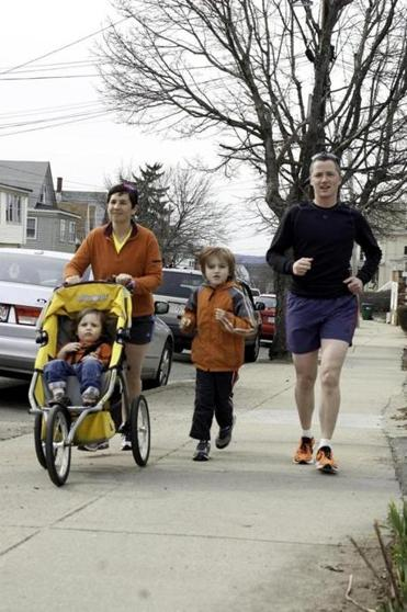 Carolyn and Jesse Edsell-Vetter during a training run with their children, Ethan, 2, and Yoni, 7.