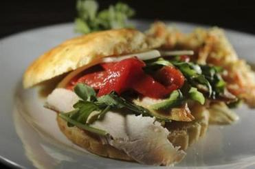 At Back Deck, a grilled Tuscan chicken breast sandwich, which can be ordered on gluten-free breads.