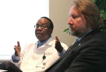 Dr. Nissage Cadet (left) and hospital president Daniel Knell discussed the strike.