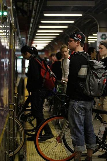 A midnight marathon rider waited with his bicycle to board the commuter line toward Hopkinton in 2012.