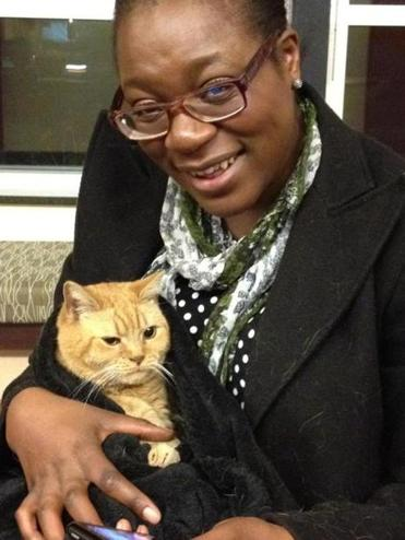 Modupe Oshikoya, a UMass Boston doctoral student, was reunited with her cat Rosie after putting up posters in Dorchester, where the cat went missing.