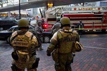 SWAT officers stand guard in Boston after the explosions.