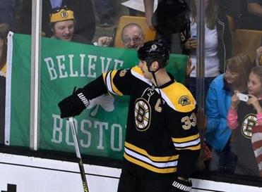 "A ""Believe in Boston"" sign greeted Zdeno Chara and the Bruins during warm-ups."