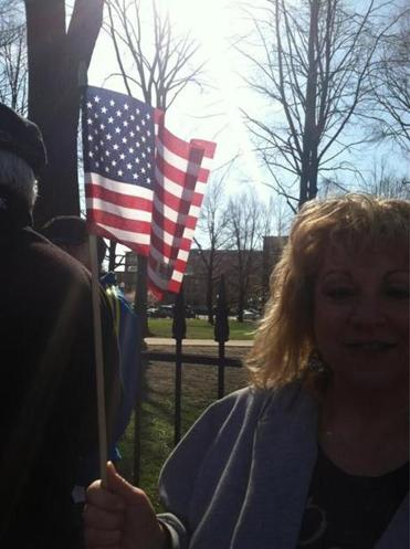 Lorri Miner of Quincy held an American flag and cried outside the cathedral.