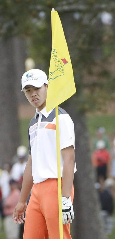 Tianlang Guan overcame a penalty for slow play to become the only amateur to make the cut at the Masters.