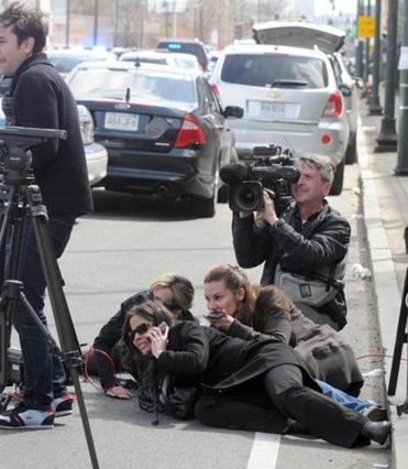 Journalists took cover during the manhunt for suspect Dzhokhar Tsarnaev in Watertown Friday.