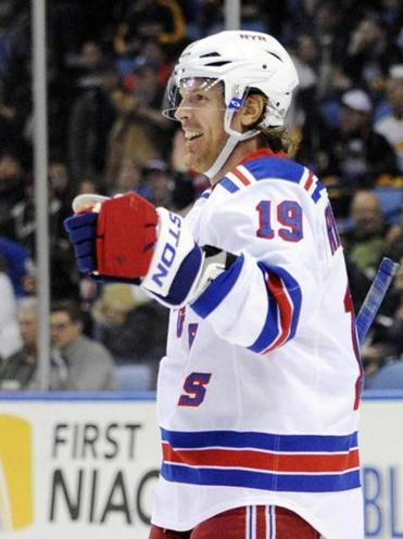 Brad Richards notched his first hat trick in an 8-4 rout of the Sabres.