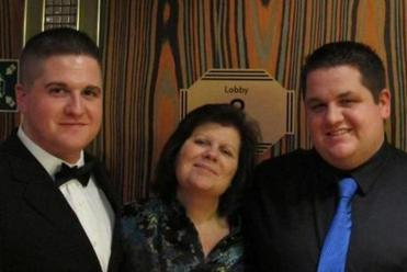 Sean Collier (at left) with his mother, Kelley, and younger brother Andrew. When he was 7, Sean persuaded Andrew not to kill an ant.