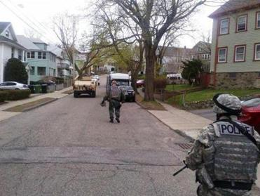 Cape Ann Regional Response Team members Sgt. Paul Francis in foreground and Lt. Mark Schmink clearing a neighborhood in Watertown.