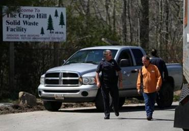 Dartmouth Patrol Officer Scott Stanton (left) checked trucks entering the landfill as the FBI conducted a search at the facility.