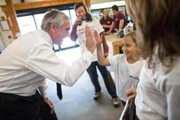 Republican candidate Michael J. Sullivan, a former state and federal prosecutor, high-fived 7-year-old Judy Rodolakis at Davidian Brothers Farm in Northborough.