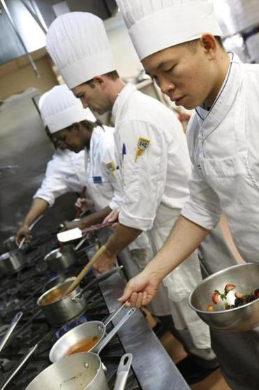 Gary Kao and Clinton Piper working on their fruit and crepe dish at Johnson & Wales.