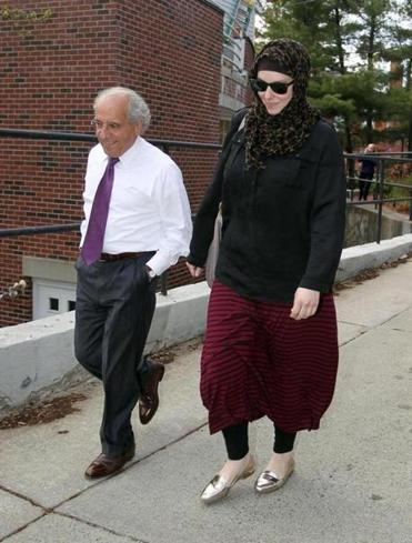 Katherine Russell, suspect Tamerlan Tsarnaev's wife, left a lawyer's office in Rhode Island with Amato DeLuca (left).