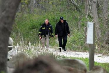 Investigators searched a wooded area in Dartmouth Friday.
