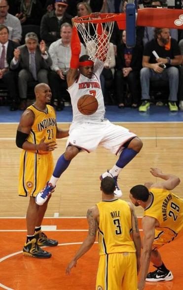 Knicks guard Carmelo Anthony threw down a two-handed dunk between three Pacers in the second half of the Knicks rout.
