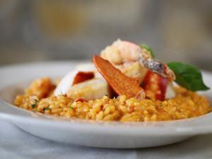 Risotto San Marion is topped with shrimp, lobster and scallops.