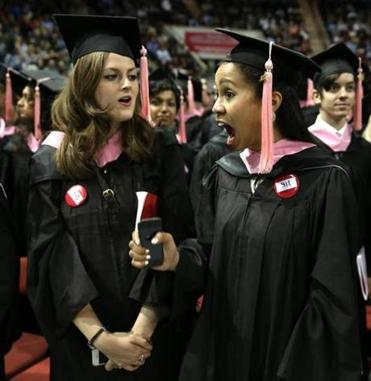 Katie Marshall (left) and Carla Martinez prepared to receive their degrees at Berklee's graduation on Saturday.