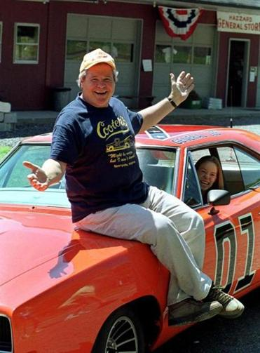 "Actor  Ben Jones, sits on the General Lee, the car used in the show ""Dukes of Hazzard"" in 1999. (AP Photo/Steve Helber)"