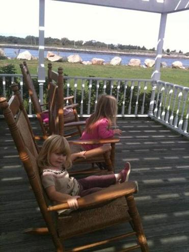 A row of rocking chairs in front of the white-shingled visitor center makes a breezy spot to watch for passing boats.