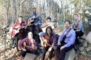 The Guitar Circle New England includes (back, from left) Rick McCarthy, Dev Ray, Scott Dozier, Chris Paquette, and (front, from left) Victor McSurely, Brad Hogg, and Alex Lahoski.