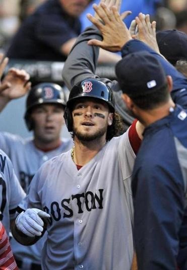 Jarrod Saltalamacchia is congratulated in the dugout after hitting a two-run home run in the third inning Monday.