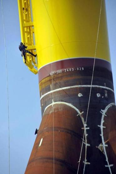 A turbine foundation in Bremerhaven dwarfed a worker.