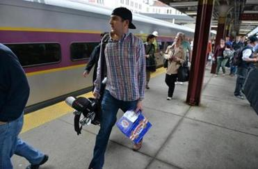 Ben Nardella of Charlestown was one of the passengers to board the first CapeFlyer train out of South Station.