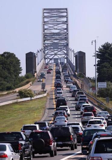 Traffic at the Bourne Bridge (shown here on Labor Day weekend last year) frequently inspires frustration — and humor.
