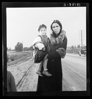 A woman with her youngest child, one of seven, on US 99 near Brawley, California.