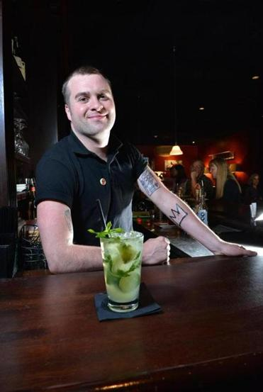 Evan Kenney with a Nantucket Mojito at West Side Lounge.