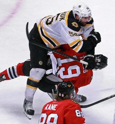 The Bruins' Johnny Boychuk's crushing hit on the Blackhawks' Jonathan Toews has left Toews's status up in the air for Monday night's game.