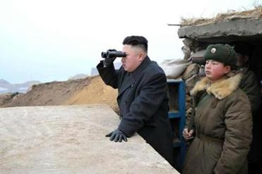North Korean leader Kim Jong Un looked south from a military obervation post on Jangjae islet.