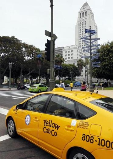 A cab in Los Angeles was part of a protest against Uber and similar services.