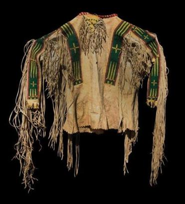 Plains Indian buckskin war shirt sold at Willis Henry's American Indian & Ethnographic Art Auction for $5,265 against a $1,000-$1,500 estimate. This 11-inch- diameter Mimbres bowl fetched $4,680 ($2,000-$3,000 estimate). A polished stone secured with rawhide was used to make this Plains Indian tomahawk (or skullcracker) that sold for $3,139 ($300-$400 estimate). It was