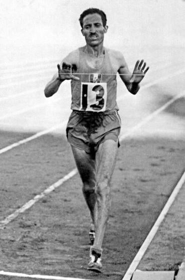 Alain Mimoun crossed the finish line first at the 1956 Olympic marathon in Melbourne, Australia.