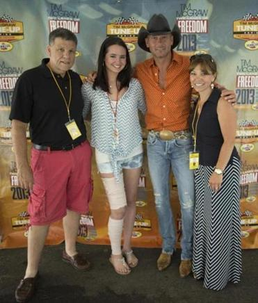 From left: WKLB-FM's Mike Bro-phey, Jacqui Webb, Tim McGraw, and WKLB's Ginny Rogers.