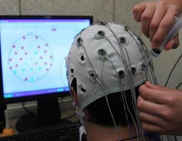 Charlie Krampf wore electrodes to monitor brain activity when he performed different visual tasks.